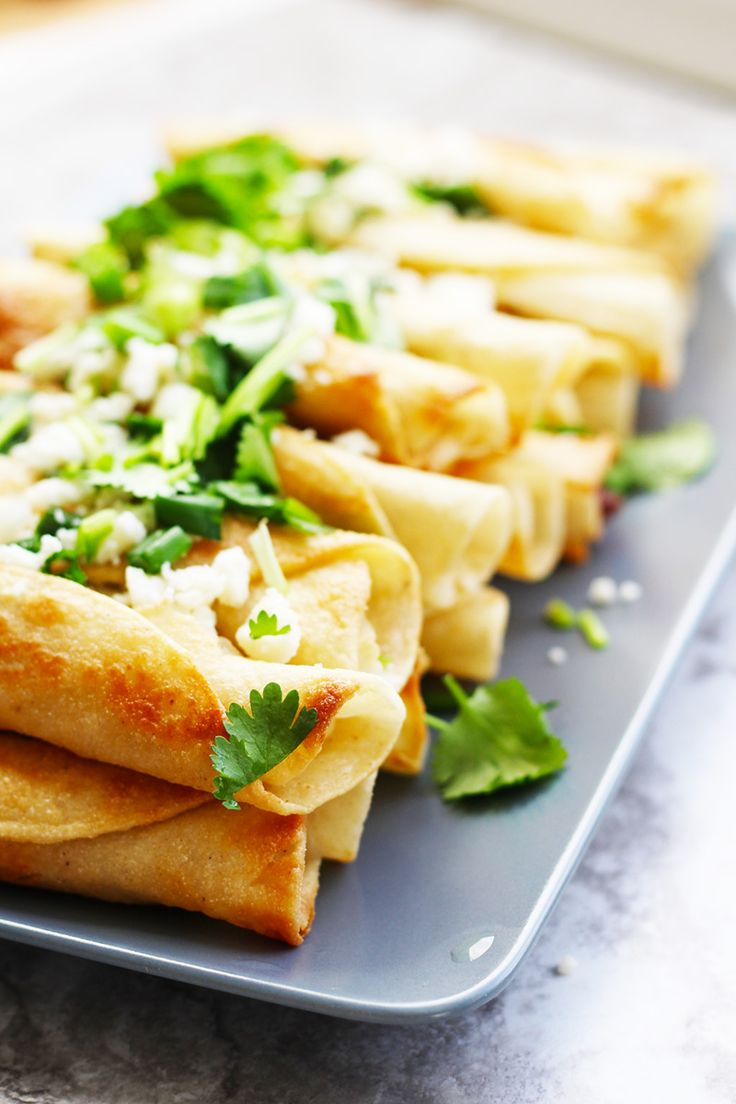 Learn how to make authentic Chicken Taquitos, also known as Flautas de Pollo.  Just five ingredients and a few garnishes makes this Mexican recipe an easy way to feed a crowd.  This recipe can easi…