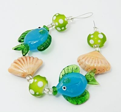 1 Strand - Down by the Water Lampwork Beads. Starting at $1 on Tophatter.com!