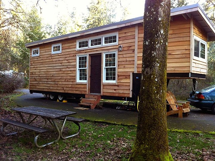 This Willamette Farmhouse is a not-so tiny house that measures 38 feet in length. The size and the weight of this tiny house build demand a heavy duty gooseneck specially designed tiny house trailer, but above the goose neck is a perfect place to put the tiny home master bedroom.