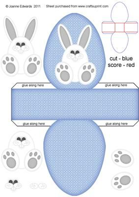 Easter Bunny Box BLUE on Craftsuprint designed by Joanne Edwards - Approx internal size once completed to fit a fondant filled egg. Just add shredded tissue paper inside to pad around the egg. Leave as it is, or attach a card/ribbon handle, or punch holes at the top to thread a ribbon through and tie a bow, which will stop the egg from falling out. Great little treat box project for children.Other box colours available are YELLOW or PINK.Also have bunny step by step toppers in several…