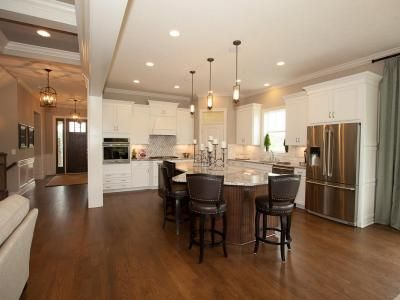 Kitchens & Baths | Photo Gallery | 3 Pillar Homes #Custom #Kitchen #CofferedCeiling #Ceiling #Island #Counters #Cabinetry #Lighting #Pantry #GreatRoom #HeavyTrim #Trim #Hardwood #Floor #Flooring #CustomHome #CustomDesign