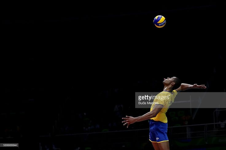 Ricardo Lucarelli of Brazil spikes the ball during the men's qualifying volleyball match between Brazil and France on Day 10 of the Rio 2016 Olympic Games at the Maracanazinho on August 15, 2016 in Rio de Janeiro, Brazil.