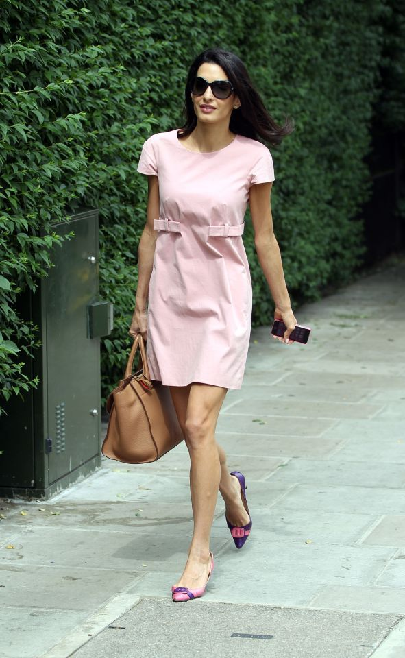 <p>A pretty pink day dress taken to the next level with mismatched shoes. <i>(Photo by Splash News)</i></p>