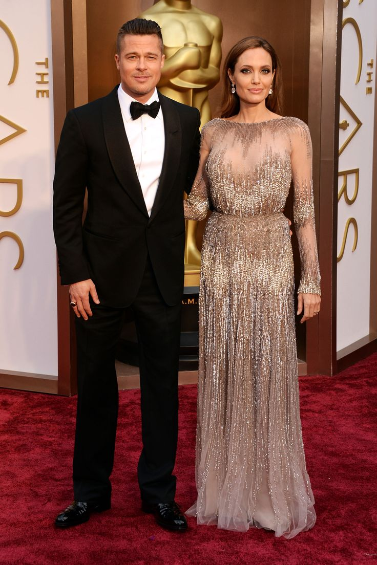 Angelina Jolie in Elie Saab, Oscars 2014 ... Her arm candy isn't too shabby either.  ;-)
