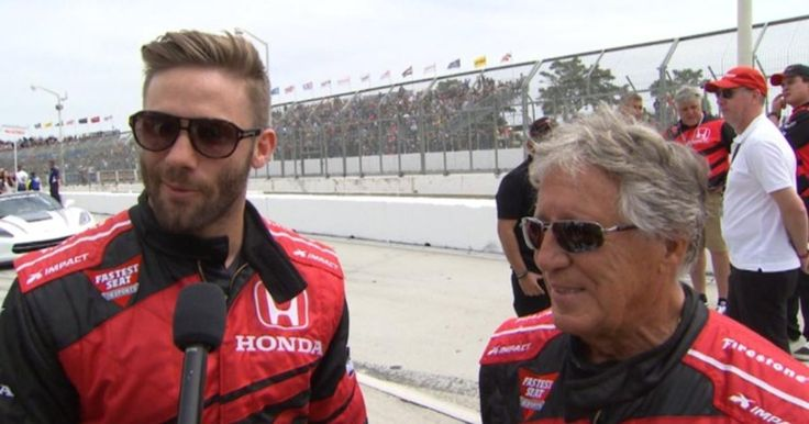 New England Patriots wide receiver Julian Edelman rides in the Fastest Seat in Sports with racing legend Mario Andretti to start IndyCar's Toyota Grand Prix of Long Beach.