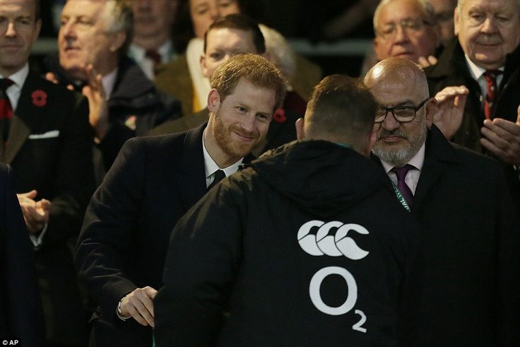 He smiled as he handed a medal to another player. Prince Harry is a patron of the English Rugby Union