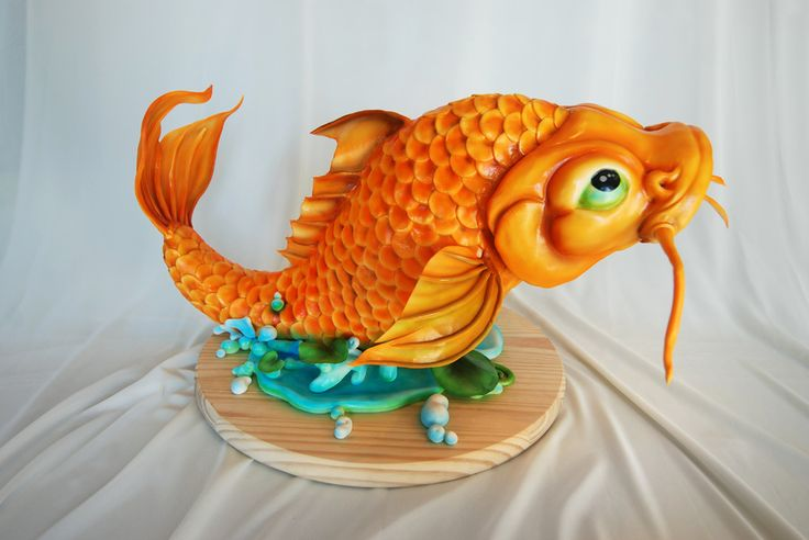 Large koi fish - done in pure white then airbrushed by Mike Elder from Black Sheep Custom Cakes