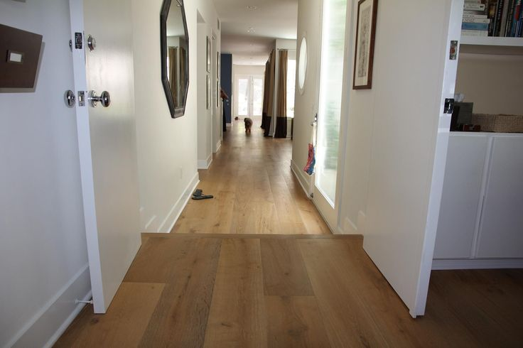 Fine brushed European white oak with natural knots & character marks that add to the look of a centuries old Italian Chateau. This exquisite wide oak hardwood flooring choice features 9.5-inch wood planks featuring a smoked lacquer finish.