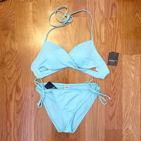 Baby Blue Bikini Set  Brand New with tags. Light blue swimsuit with a chic style. The top is a spaghetti strap halter with a crisp cross cut out. The bottom has bow ties on the sides. Both are a size Medium. Great for the spring & summer! Hollister Swim Bikinis