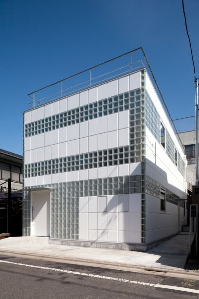 "'""..the design utilizes a system of steel flat bars, glass blocks, and ALC panels to create a non-supporting 'free facade' which could be finished in a limitless pattern..""  In the interior the glass brick offers abundant natural light and graphic opportunity.  One may question ventilation and anti-seismic considerations..'"