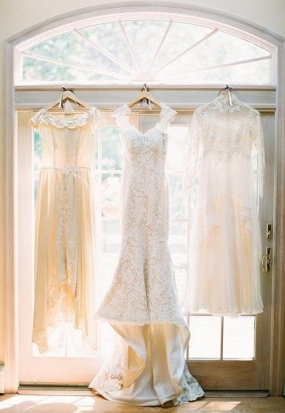 Grandmother and mother's wedding dresses with the bride's. I love this representation of the generations!