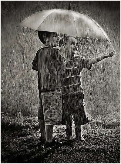 As a child I loved playing with an umbrella in the rain, so I know the pleasure that they're feeling.