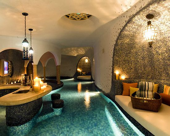 Indoor #pool with tons of beautiful #tile and a fun-looking swim-up #bar. Brilliant!
