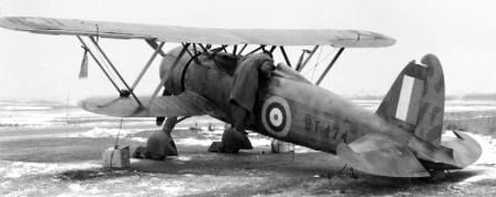 Fiat CR.42 Falco catturato durante la Battaglia d'Inghilterra. Il velivolo fu costretto ad un atterraggio forzato sulla spiaggia di Orfordness, Suffolk, l'11 November 1940. Ora si trova al Royal Air Force Museum di Hendon, con la matricola MM5701, 13-95. (RAF Photo)