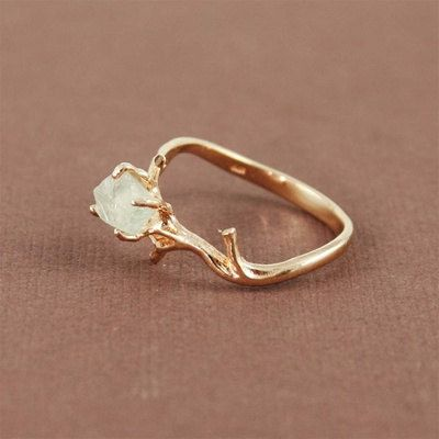 This ring with natural green amethyst stone. | 65 Impossibly Beautiful Alternative Engagement Rings You'll Want To Say Yes To
