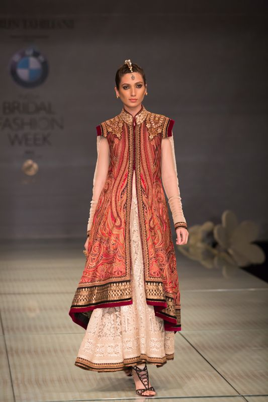 Tarun Tahiliani red jacket ivory lehnga. More here: http://www.indianweddingsite.com/bmw-india-bridal-fashion-week-ibfw-2014-tarun-tahiliani-show/