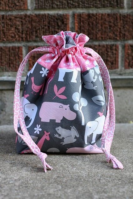 Lined Drawstring Bag Tutorial: Use to wrap a gift (two gifts in one!), line with PUL fabric for a waterproof bag.