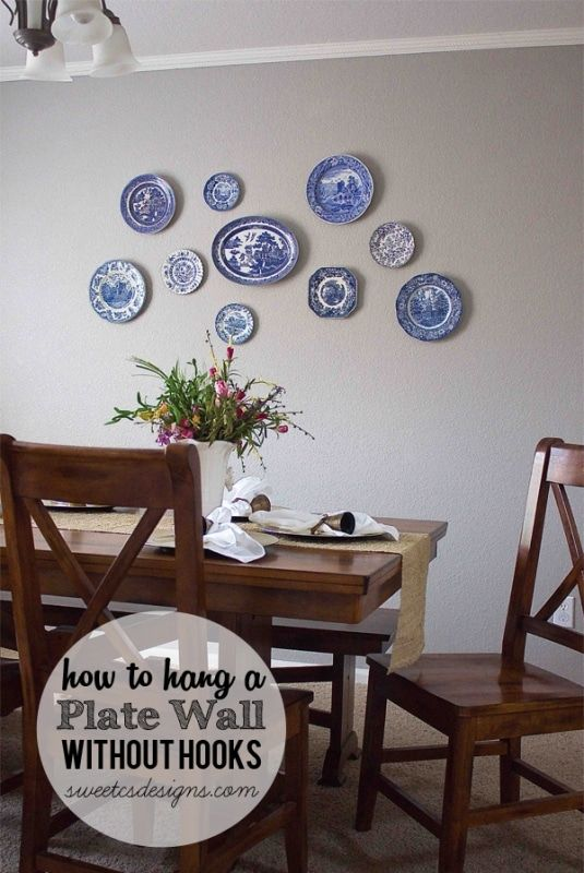 How to hang a plate wall without hooks at sweetcsdesigns.com- this is such an easy tip! No more hooks showing from plates and you can move plates around easily! #homedecor #plates #diy