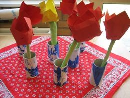 "Folk art project for the young kids on the theme of spring or the Netherlands--paper tulips in ""delftware vases"" (painted toilet paper rolls)"