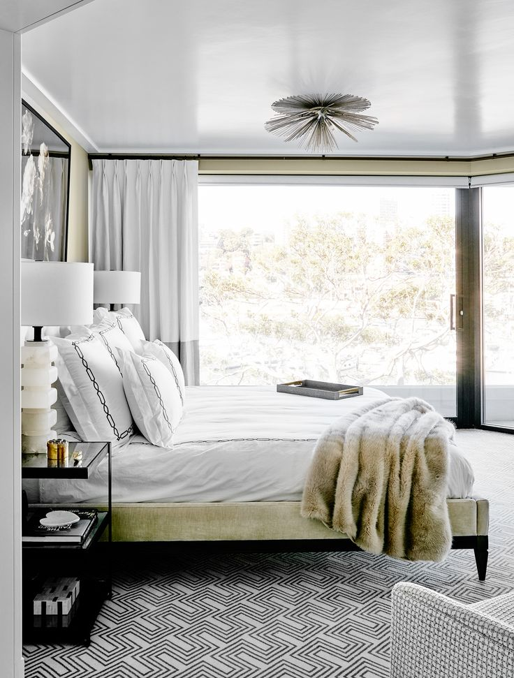 The geometric carpet and  luxe velvet bedframe hit the Park Avenue brief for this apartment in Sydney's Elizabeth Bay. Photography: Will Horner