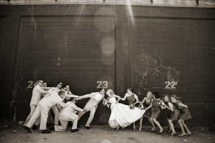 this is adorable!  bride-groom tug of war