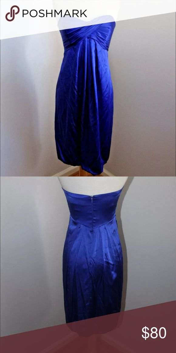 Nicole Miller Strapless Bubble Dress Royal Blue COLOR IS ROYAL BLUE ( WHICH IS CLOSE TO NAVY) Sophisticated yet playful with its bubble hemline. *Silk; lining:silk *Dry clean *Made in USA *Strapless *Sweetheart neckline *Ruched swirl detail at bust *Pleated below empire waist at front; pleated below waist at back *Bubble hem *Lined *Back zip closure *Hits above knee; approximate length at center(from below open back):30 inches *Item was used as a floor model for High-End Department Store,no…