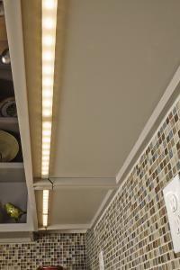 Tresco (by Revashelf) under cabinet LED strip lighting.