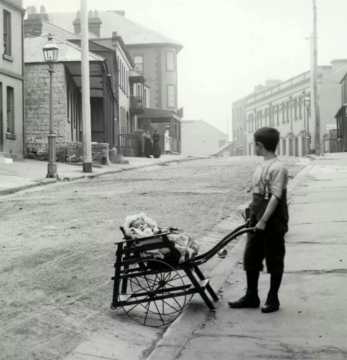 Boy pushing pram in Gloucester St,The Rocks in c1890.A♥W. History NSW