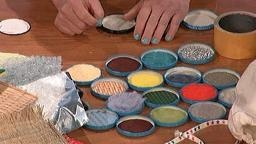 Superglue jam jar lids to board (use lids to contain sensory items)