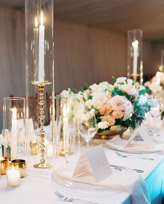 We can't get enough of candle wedding centerpieces. They're timeless, classy, and oh-so-pretty, with an old-timey vibe that can be revamped for a modern feel. From store-bought selections to homemade, DIY fixtures, these warm, glowing decorations offer elegance, allure, and beauty to any tablescape. Whether pillars, tapers, votives, or tea lights, there's nothing like a flickering flame to give your wedding reception beautiful ambience. Plus, they have the added benefit of casting a…