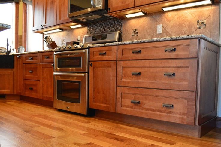 Medallion Cabinets for a Craftsman Kitchen with a Range and Fall Haven by Castle Kitchens and Interiors