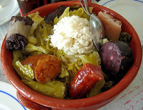 Cozido á Portuguesa - A mix of various types of meat, sausage, vegetables, potatoes, and rice, all baked.