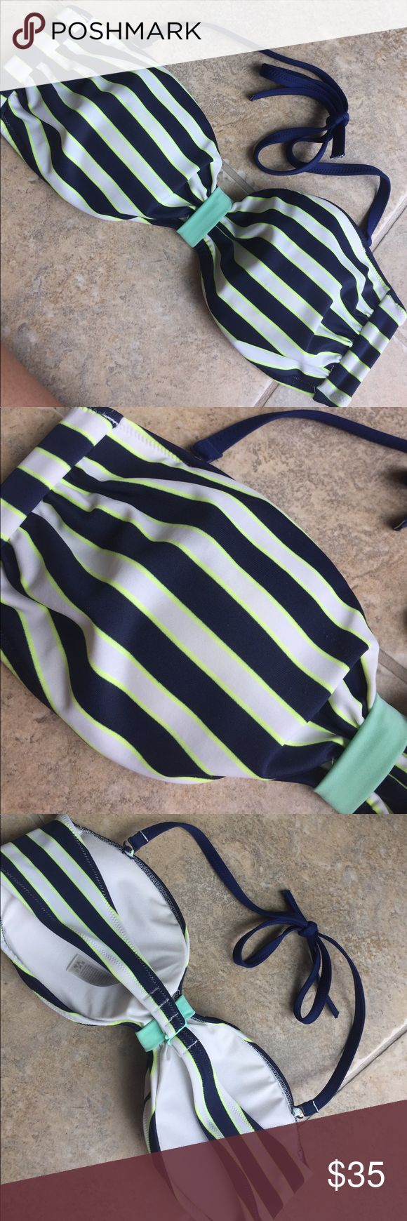 Victoria's Secret stripe bikini top bandeau large Cute Victoria's Secret bikini top. It is navy blue turquoise lime green and white. It is a size large from the pink collection. It's in good used condition. It has a detachable shoulder strap. PINK Victoria's Secret Swim Bikinis