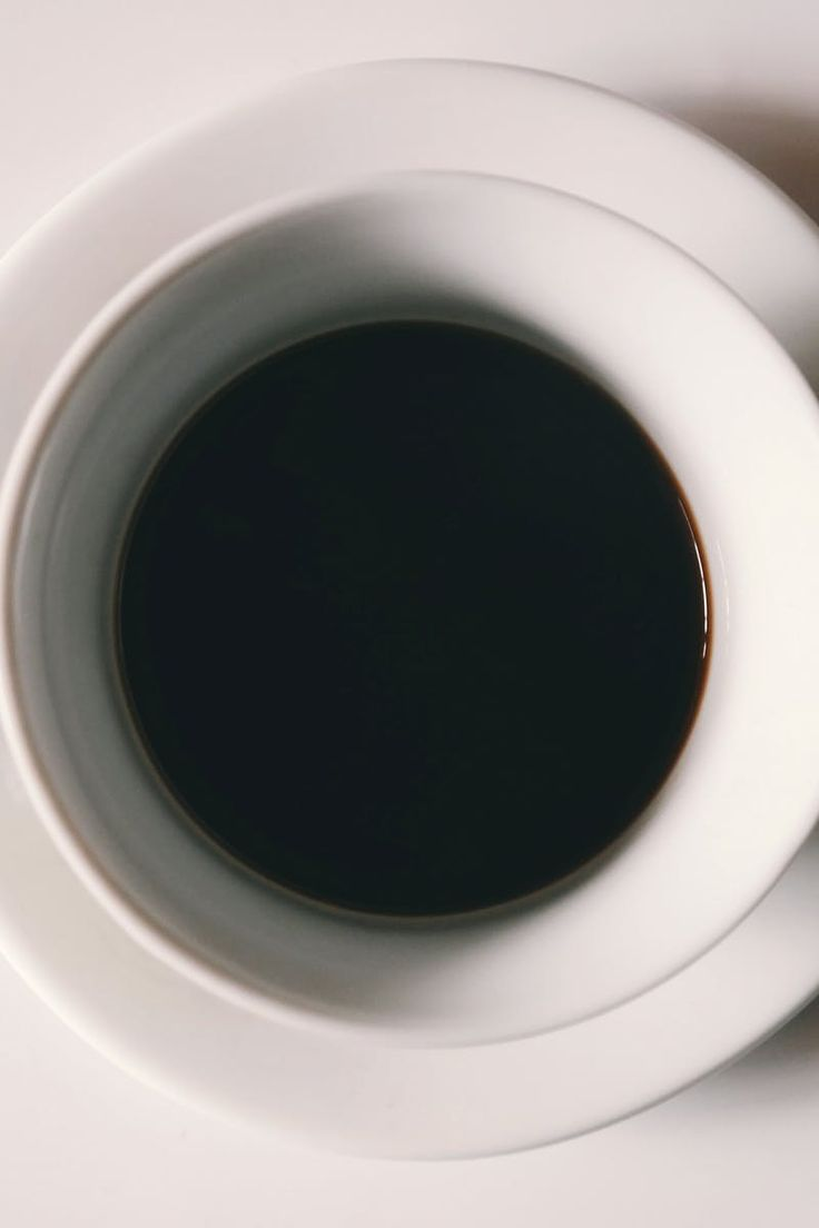 Black Liquid in White Ceramic Mug
