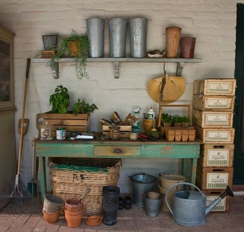 A great way to display all the gardening tools, watering cans, and pots.