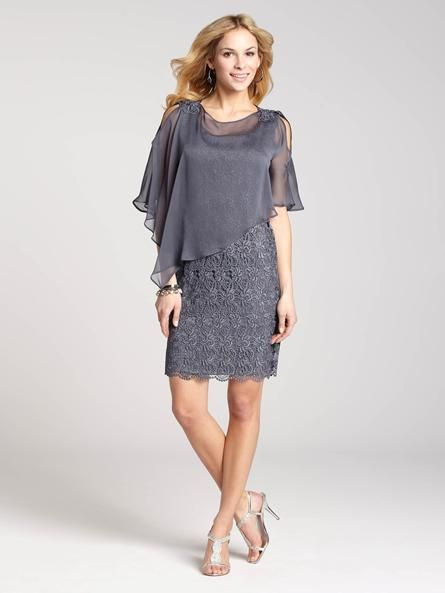 "Laura Petites: for women 5'4"" and under. The grey coloured lace of this shift dress whispers quiet sophistication, while the detachable asymmetric chiffon capelet overlay is perfect for those who want a little extra coverage. Pair with silv4010103-0337"