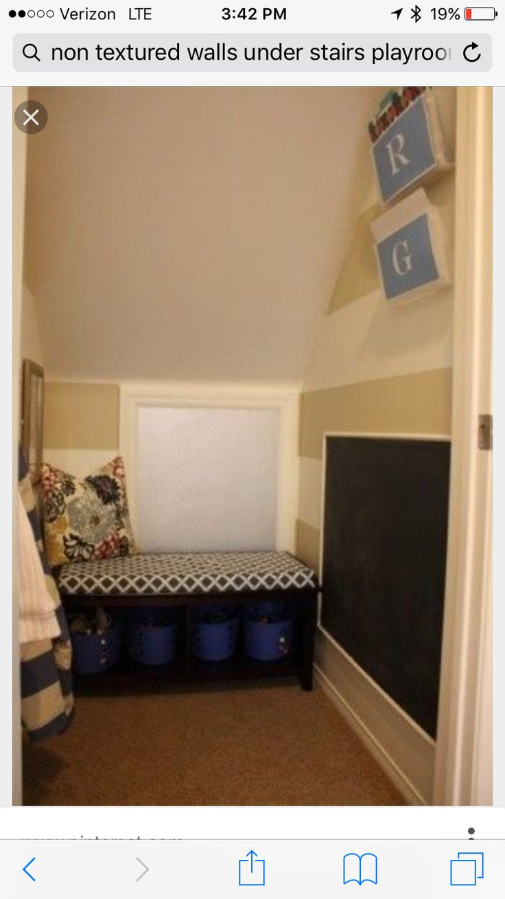 Under the stairs art room/kid hideout by pamela