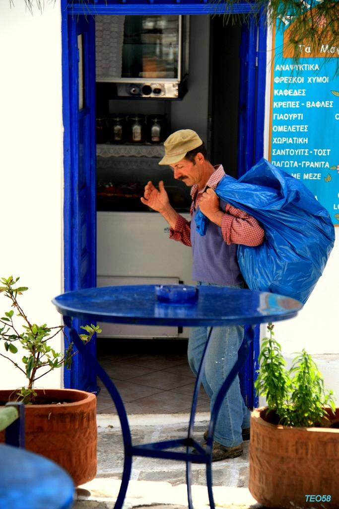 Life in blue Lefkes village, Paros island, Greece.