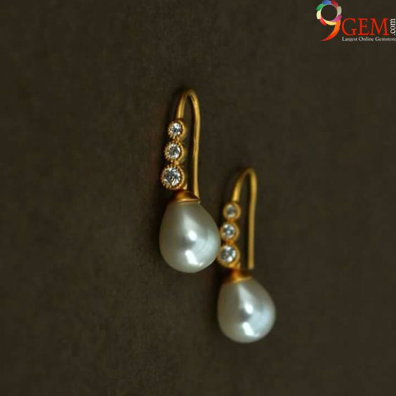 White zircon and pearl earrings with gold is a perfect jewelry matching with your attire