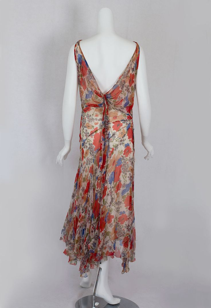 Floral chiffon dress with low cut back, 1930s. The slinky, form fitting silhouette and hip-seam detail anticipate the longer styles of the 1930s. The hybrid style combines a sophisticated 1930s silhouette with an endearing floral print, whose sunny hues—for a 1930s viewer—symbolized the unbounded optimism of the carefree 1920s.