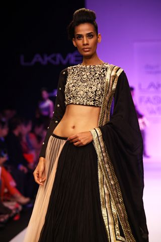 Black Silk Mul Choli and Black - Blush Mul and Net Half Embroidered Lehenga. Shop The Look at http://www.payalsinghal.com/off-the-runway/gul-lehenga