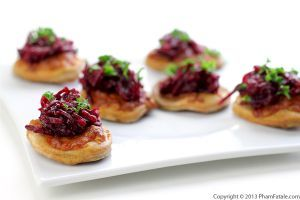 Here\'s a fusion version of pizza made with spicy beets. The pizza dough is baked separately then topped with Indian beets and dal. It\'s perfect for vegetarians since it\'s packed with protein.I usually serve them as appetizers. They would also be a great addition to a party platter because of the pop of color and exotic flavors.
