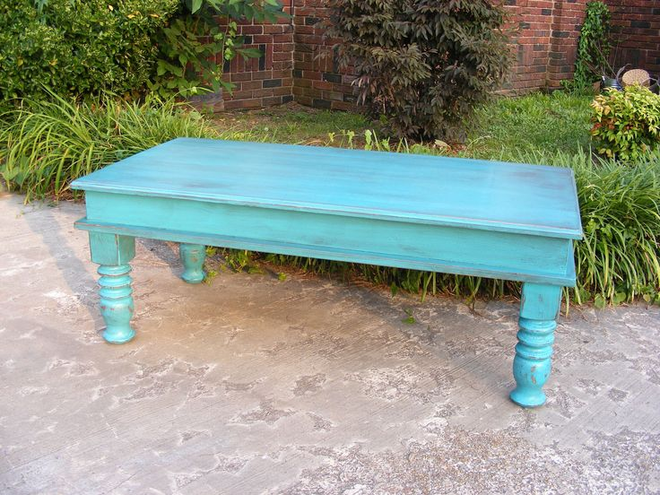 Mystic Blue Coffee Table with Beautiful Hand Carved Legs And Hinged Top For Storage. $295.00, via Etsy.