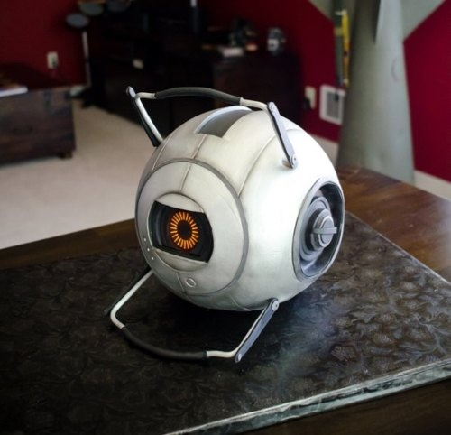 This is such an awesome looking cake! It's a Personality Core from Portal 2. I wonder if it was as delicious as it is cool.  Portal 2 Personality Core by Mike's Amazing Cakes, via Geeks are Sexy: http://www.geeksaresexy.net/2011/07/26/space-core-cake-pic/