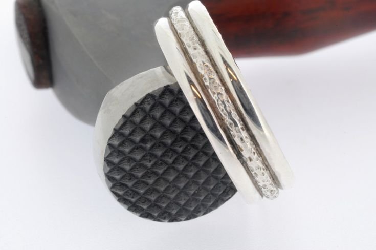 Creating subtle textures on silver rings with textured hammers from Bill Fretz and Rio Grande Jewelry Supplies.