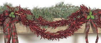 Awesome idea for the holidays. Dried chilies tied along with garland. :)