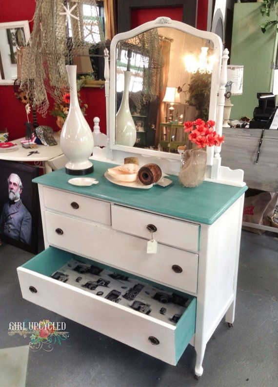 Love this salvaged dresser updated with painted drawers and a hip black and white vintage camera fabric lining.