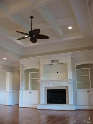 ceiling coffer and fireplace wall with built-ins