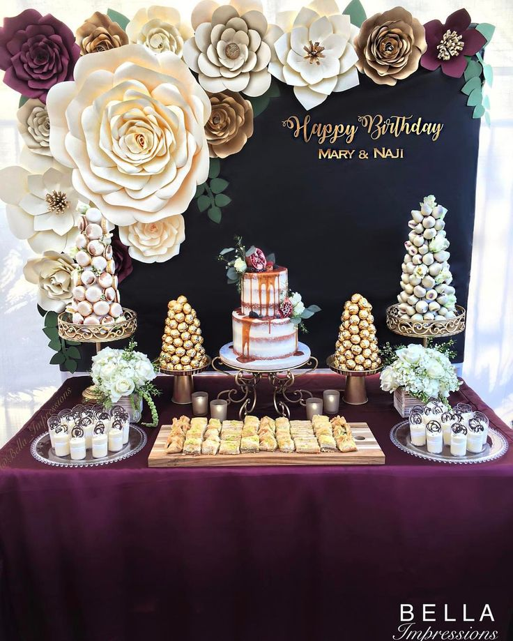 BELLA Impressions | IG @Bella_Impressions | Etsy Shop: https://www.etsy.com/shop/BellaImpressionsShop | Website: Bellasimpressions.com  Burgundy and Gold | Rustic Glam. @bella_impressions Burgundy & Gold Dessert table - paper flower backdrop - Dessert towers - cakes - name sign - ferrero rocher tower - French macaron tower - chocolate covered strawberry tower - paper flowers -  french macarons    For rent or purchase. Southern ca. LA • OC • IE We ship flowers nationwide.