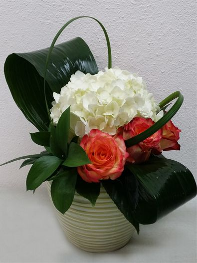Roses, hydrangeas, lily grass, aspidistra leaves and ruscus.